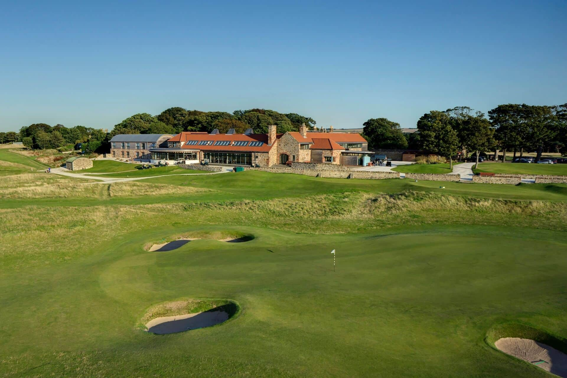 The 9th Green and clubhouse at Craigielaw Golf Club